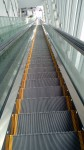 An escalator three stories high