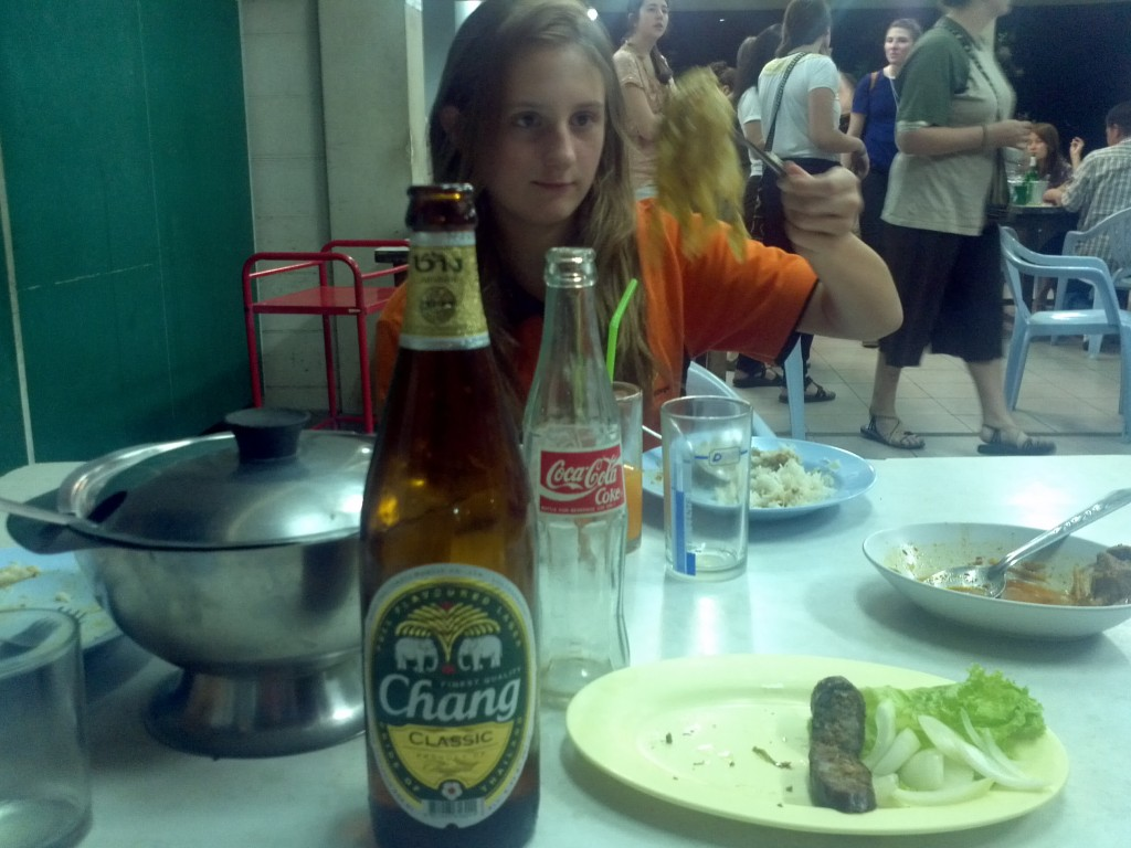 Eating traditional Northern Thai food with Chang beer and the weird sausage