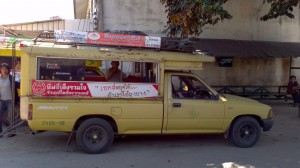 Thai style bus - a songthaew.  The kind of vehicle Ainlay jumped from in order to break her wrist.