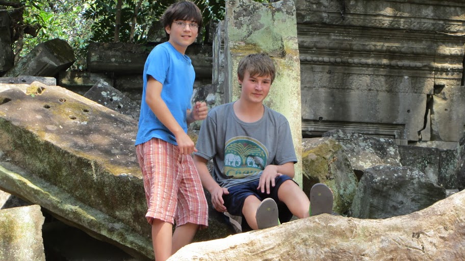 Hank and David Evan climbing on Khmer temples