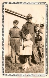 Dad with his father, sister Jean and brother Doug.  Dad's the fat one.