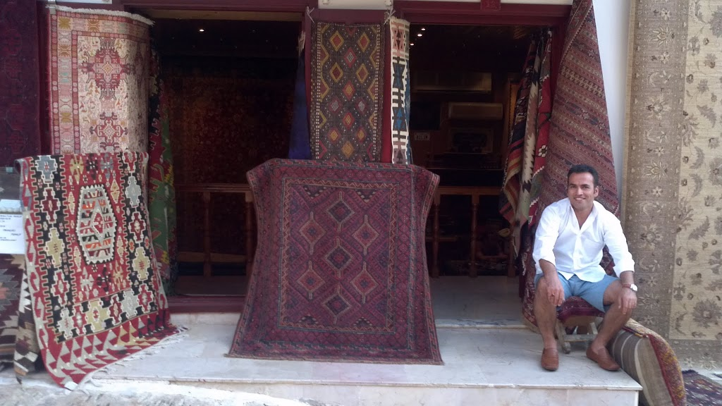 Rug seller in Kaş